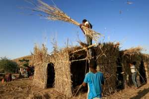 Ethiopian refugees build a house in the Um Raquba camp in Sudan, some of the more than 36,000 Ethiopians who have fled fighting in the northern Tigray region.  By ASHRAF SHAZLY (AFP)