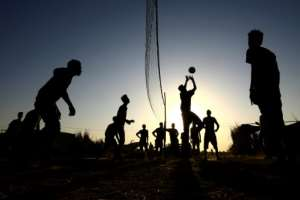 Ethiopian refugees who fled fighting in Tigray province play volleyball at the Um Raquba camp.  By ASHRAF SHAZLY (AFP)
