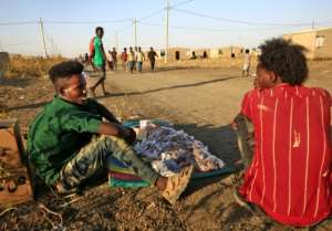 Ethiopian refugees who had savings quickly bulk-bought food and other goods that they can sell after fleeing into Sudan.  By ASHRAF SHAZLY (AFP)