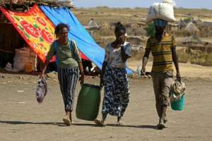 Ethiopian refugees who have fled the Tigray conflict in a transit centre in the Sudanese border town of Hamdayit -- many were separated from loved ones in their scramble to leave their homes.  By ASHRAF SHAZLY (AFP)