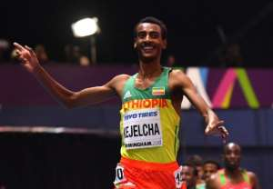 Ethiopia's Yomif Kejelcha, shown winning last year's world indoor 3,000m title, won the mile Saturday at the Millrose Games with the second-fastest time in history, .01 off a world record.  By Ben STANSALL (AFP/File)