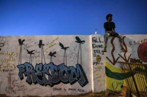 Even as Sudanese graffiti artists enjoy their first stroke of freedom, they all complain of a shortage of materials. By OZAN KOSE (AFP/File)