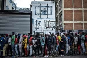 Experts fear that overcrowding in Africa -- such as in this queue for food in Johannesburg -- could mean it is hotspot waiting to happen.  By MARCO LONGARI (AFP)