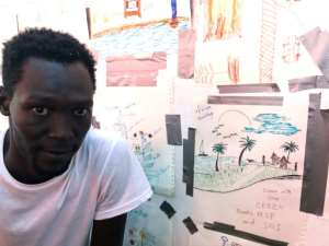 Ezzo's drawing depicts his lakeside village near the Nuna Mountains in southern Sudan.  By Anne CHAON (AFP)