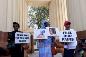 Family members who lost loved ones to repression during Yahya Jammeh's two-decade rule in Gambia hold a protest in April 2018.  By CLAIRE BARGELES (AFP/File)