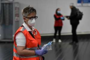 Face masks were handed out at a train station in Madrid Monday as lockdown restrictions were slightly eased.  By PIERRE-PHILIPPE MARCOU (AFP)