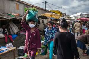 Facemasks, herbs and spices: Ambodivona has been even busier than usual since President Andry Rajoelina announced confinement measures, prompting the market to close every day at noon.  By RIJASOLO (AFP)