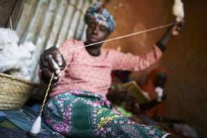 Facilities which take the tufts of cotton and spin them into yarn, let alone weave the yarn into cloth, are rare in Mali.  By MICHELE CATTANI (AFP/File)