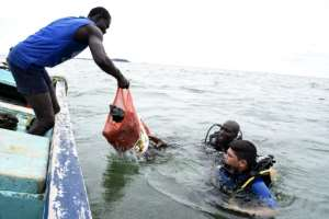Farewell, rubbish: Scuba divers bring up plastic waste and other items collected from a bay off Dakar.  By SEYLLOU (AFP)