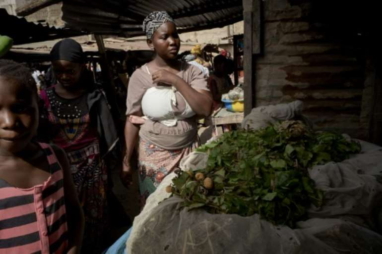 Fatoumata Sinaba rised at 4am to prepare her family for a day of fast before heading to the market to buy vegetables for the Iftar.  By MICHELE CATTANI (AFP)