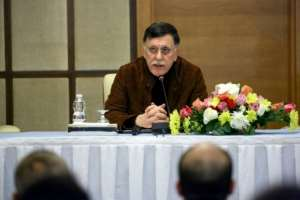 Fayez al-Sarraj, head of Libya's Government of National Accord, will participate in a peace conference on Libya in Berlin, but his rival Khalifa Haftar has not confirmed his attendance.  By Mahmud TURKIA (AFP)