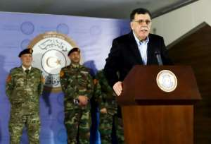 Fayez al-Sarraj, Prime Minister of Libya's UN-recognised Government of National Accord), holds a press conference in the capital Tripoli on Monday.  By - (AFP)
