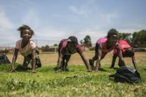 Female players from the Soweto Rugby Schools Academy train hard.  By Guillem Sartorio (AFP)