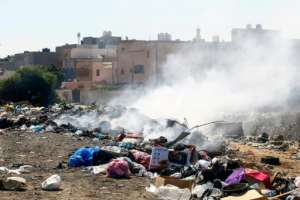 Fed up by the smell and the sight of rats and stray cats feasting in the garbage, some Tripoli residents have taken to burning the rubbish.  By Mahmud TURKIA (AFP)