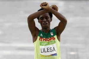 Feyisa Lilesa dramatic crossed-wrist protest made headlines and shone the spotlight on a sometimes brutal government crackdown against Oromo protesters.  By Adrian DENNIS (AFP/File)