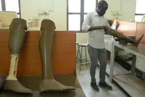 Finished prosthetic limbs. By SIMON MAINA (AFP)