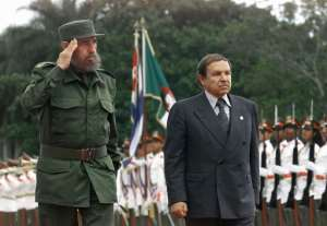 Fidel Castro and Abdelaziz Bouteflika attend a ceremony in Havana, Cuba on April 15, 2000 during an official visit by the Algerian president. By ADALBERTO ROQUE (AFP/File)