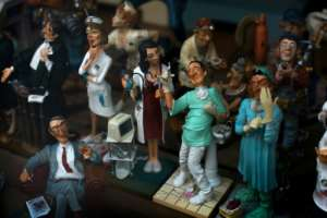 Figurines depicting medical personnel are displayed in the showcase of a store in Ronda, Spain.  By JORGE GUERRERO (AFP)