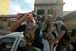 Fighters loyal to the GNA celebrate on April 13, 2020 after seizing the coastal city of Sabratha from Haftar's forces.  By Mahmud TURKIA (AFP/File)
