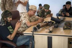 Fighters loyal to Libya's internationally recognised government play the online video game
