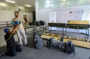 Fighters loyal to Libya's internationally-recognised Government of National Accord display US-made Javelin anti-tank missile and precision guided munition reportedly seized from forces loyal to General Khalifa Haftar.  By - (AFP)