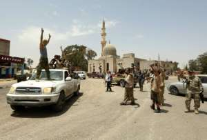 Fighters loyal to Libya's UN-recognised government celebrate victory over strongman Khalifa Haftar's forces in Tripoli.  By Mahmud TURKIA (AFP)