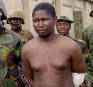 File picture of Boko Haram founder Mohammed Yusuf at Giwa Barracks in Maiduguri on July 30 2009, shortly after his capture by Nigerian troops.  By  (AFP)