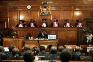 File picture of Kenya's Supreme Court judges at a hearing last November into a complaint over the electoral commission's handling of the repeat elections. Philomena Mwilu is third from the left.  By YASUYOSHI CHIBA (AFP)