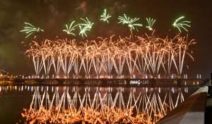 Fireworks light up the sky over the General de Gaulle bridge and the Ebrie lagoon during New Year's celebrations in Abidjan, Ivory Coast.  By SIA KAMBOU (AFP)