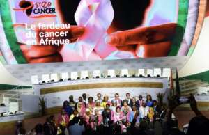 First ladies of the countries members of the African Union pose for a family picture in front of a poster for their new cancer initiative.  By ISSOUF SANOGO (AFP)
