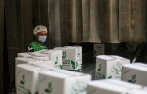Food boxes await distribution to those left in severe poverty due to Egypt's lockdown.  By Mohamed el-Shahed (AFP)