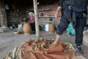 For most of the hundreds of potters in the valleys surrounding Sejnane it is a secondary source of income but for some it keeps the household going. By FETHI BELAID (AFP)