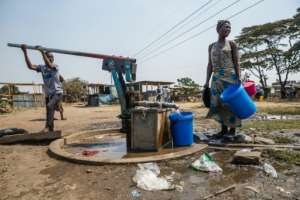 For the majority, public boreholes are the only option.  By Jekesai NJIKIZANA (AFP/File)