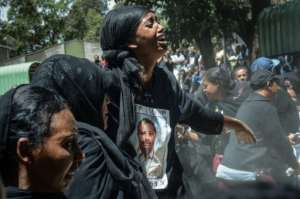 For those in mourning, it was even harder not to have any physical remains to bury, with the government saying it could take six months to identify the victims. By Samuel HABTAB (AFP)