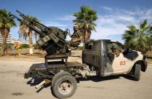 Forces loyal to Libyan strongman Khalifa Haftar man pickup trucks in Benghazi on October 24, 2018.  By Abdullah DOMA (AFP)
