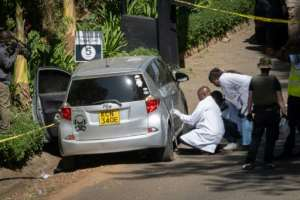 Forensic police officers investigate an abandoned car alledged to have been used by attackers, at the entrance of a luxury hotel complex attacked by Islamists in Nairobi on Tuesday.  By Yasuyoshi CHIBA (AFP)