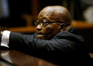 Former South African president Jacob Zuma, shown here awaiting a court hearing in November, faces 16 counts of graft linked to an arms deal from before he became president.  By ROGAN WARD (POOL/AFP/File)
