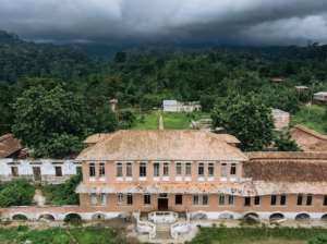 Former workers from the Agostinho Neto cocoa plantation now live in what is left of the hospital building on the site.  By Alexis HUGUET (AFP)