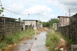 Flooded roads in a district of Libreville where houses have been built without coherent planning.  By STEVE JORDAN (AFP)