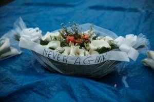 Floral offerings at a mass grave at the Kigali Genocide Memorial.  By Yasuyoshi CHIBA (AFP/File)