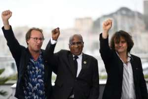 (From L) French director Nicolas Champeaux, South African anti-apartheid campaigner and former political prisoner Andrew Mlangeni and French co-director and screenwriter Gilles Porte present at Cannes
