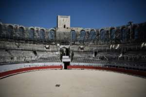 France has extended its nationwide coronavirus lockdown through mid-May 2020 -- here, a cat crosses the empty amphitheater in Arles.  By Anne-Christine POUJOULAT (AFP)