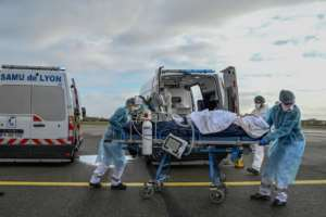 France is using aircraft to transfer patients between hospitals amid its new wave of cases.  By Philippe DESMAZES (POOL/AFP)