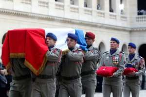 France's highest award, the l'legion d'Honneur was placed on each of the coffins.  By Thibault Camus (POOL/AFP)