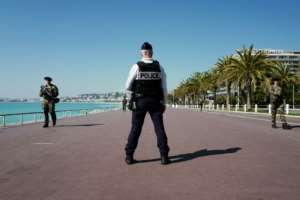 French police are on patrol in the French Riviera city of Nice.  By VALERY HACHE (AFP)