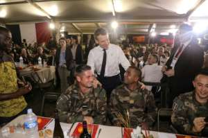 French President Emmanuel Macron addressed French troops at a Christmas dinner.  By Ludovic MARIN (AFP)