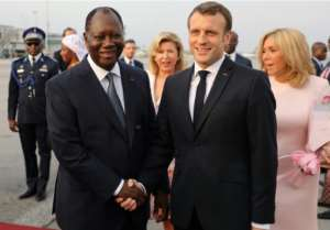 French President Emmanuel Macron and his wife Brigitte were greeted by Ivorian President Alassane Ouattara.  By LUDOVIC MARIN (AFP)