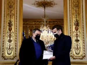 French President Emmanuel Macron (R) meets in January at the Elysee Palace with historian Benjamin Stora for a report on France's colonisation of Algeria and the Algerian War for independence..  By CHRISTIAN HARTMANN (POOL/AFP)