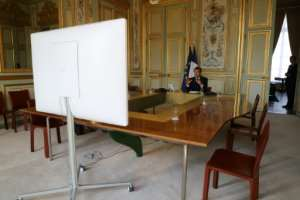 French President Emmanuel Macron speaks by videoconference with World Health Organization chief Tedros Adhanom Ghebreyesus at the Elysee Palace on April 8, 2020.  By Ludovic MARIN (POOL/AFP/File)