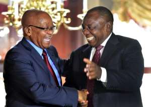 Frenemies? Zuma, left, and Ramaphosa shake hands at a farewell cocktail function for Zuma, in a picture released by the South African government.  By Kopano Tlape (GCIS/AFP)